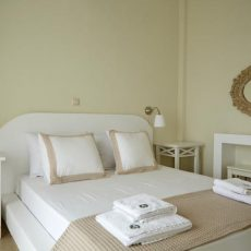 bedroom with high quality linen and minimal decor for relaxing holidays